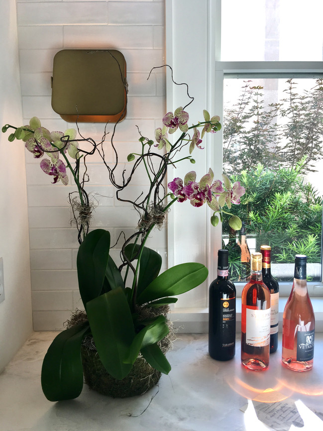 Orchids, Wine and Pretty Sconces make everything better!