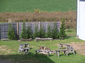 seating around the fire pit outside the barn