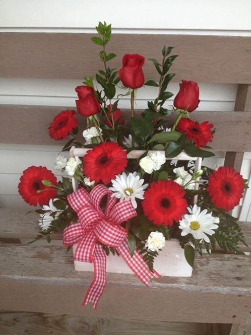 Red rose and Gerber bouquet in country wooden container