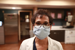 Olinee, a senior nurse at a Florida hospital relying on the Command Center capability.