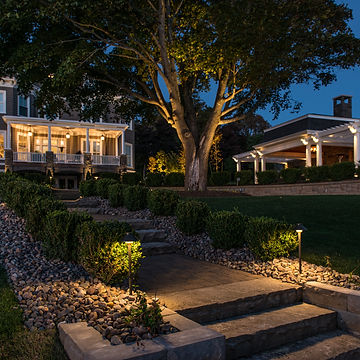 Home and sidewalk well lit with outdoor lighting