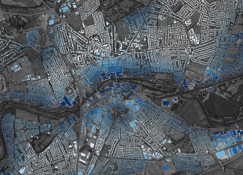 Map showing buildings coloured by distance to water (darker blue, closer to water)