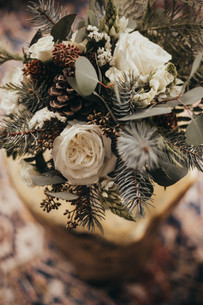Winter Inspired Bridal Bouquet of Pine and Roses