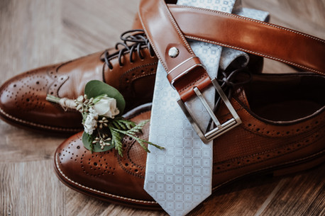 Groom Detail Shot of wedding day accessories in Rossland BC