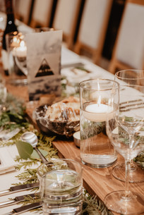 Winter Wedding Tablescape of pine table runner and floating candles at The Josie Hotel In Rossland BC