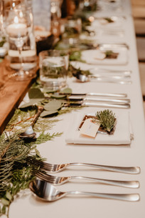 Winter Apre Ski Place setting with chocolate favor and pine florals