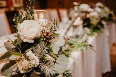 Winter Wedding Table Florals of Pine and White Roses in Rossland BC