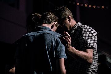 Praying men_edited.jpg