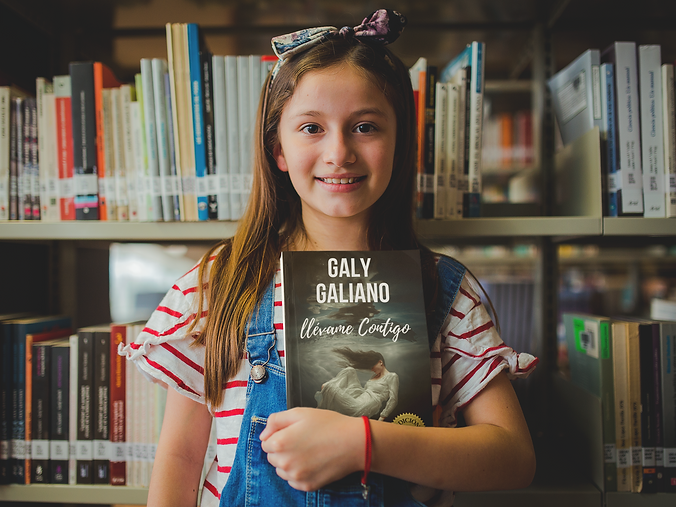 happy-little-girl-holding-a-book-mockup-