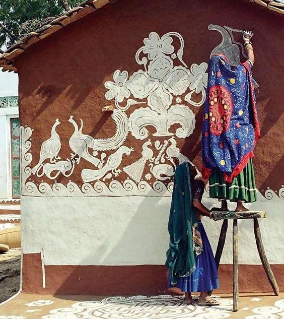 indian women painting wall.jpg