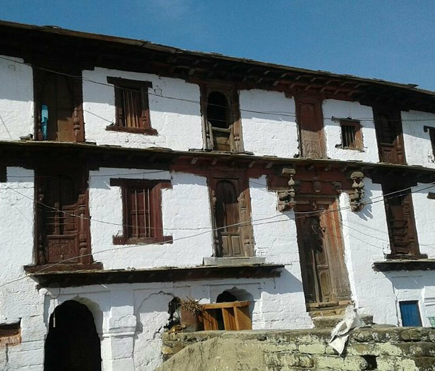 indus row of homes whitewashed with wood