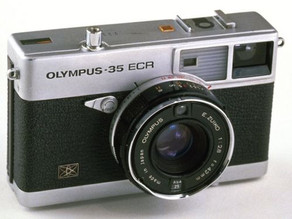 A Change of Focus for Olympus