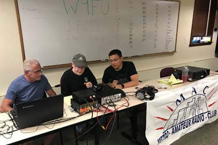 Steve Wa9FZB, Mayor Van Dusen and Lyam N9LVG make a QSO