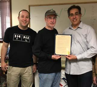 Avi W2GKG, Skokie Mayor George Van Dusen and Henry K9KDE hold the Amateur Radio Week Proclamation.