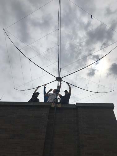 Erecting the hex beam antenna on the roof.