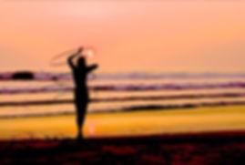 Hula hoop on the beach sunset