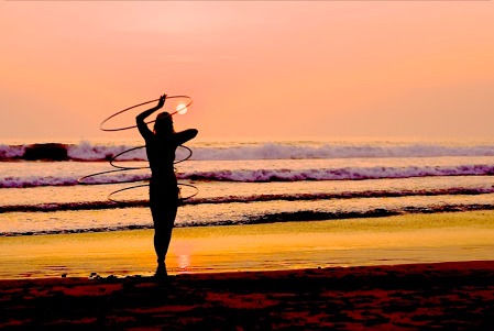 Hula hoop on the beach sunset