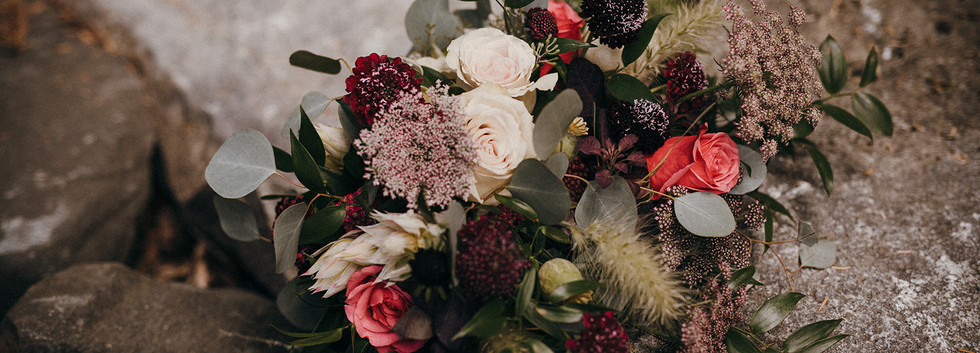 Lush blush and burgundy bridal bouquet with pops of bright raspberry