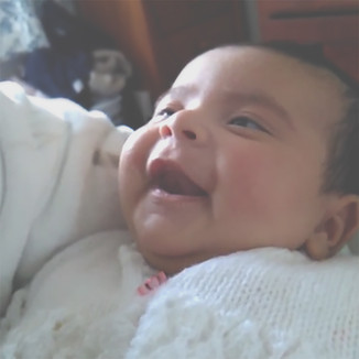 She actually started smiling by week 3 and I've failed at capturing a smile, so I had to freeze a video frame. She does this little giggle when she is amused... exactly like me! Smiles, coo's and giggles - that's what I live for right now.