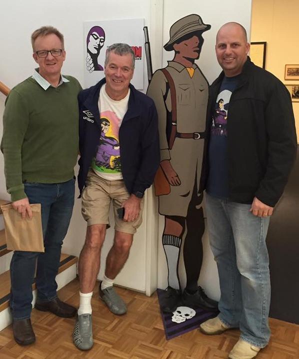 Phans Chris Hill, Gary Horne and Dan Fraser flank Dietmar Lederwasch's Jungle Patrol figure at the entrance of the Toowomba Regional Art Gallery