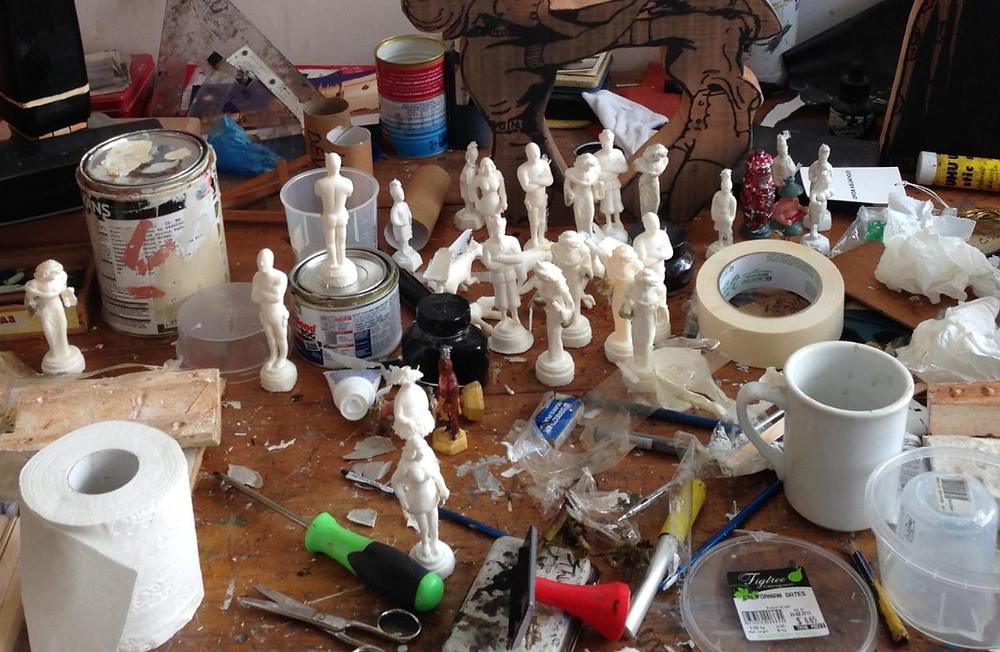 Kingston's work bench with figurines cast and ready for paint