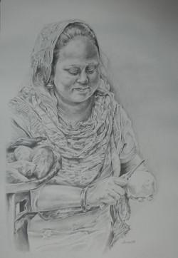 Woman Peeling Potatoes (India)
