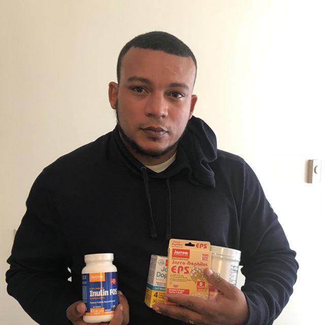 Me, holding probiotics you should take