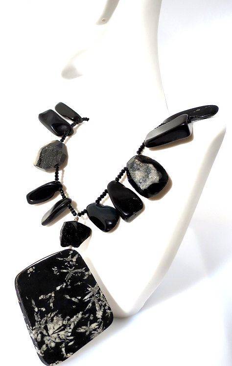 Chrysanthemum Stone Pendant accented with Onyx,