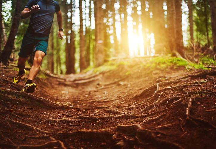 man-trail-running-in-the-forest-royalty-