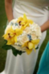 bridal bouquet of cream roses, blue tweedia flower, stephanotis, and gold cymbidium orchid weddings by anderson florist tillamook Oregon