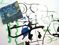 A child's painting, blue and green on white paper.