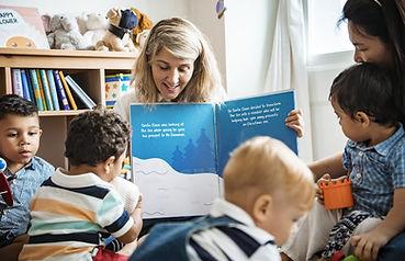 A teacher reads a book about winter to a preschool class
