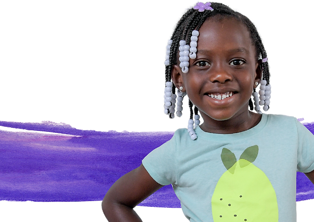 A preschool-aged girl smiles at the camera, hands on hips