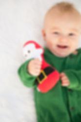 Baby with Santa Rattle.jpg