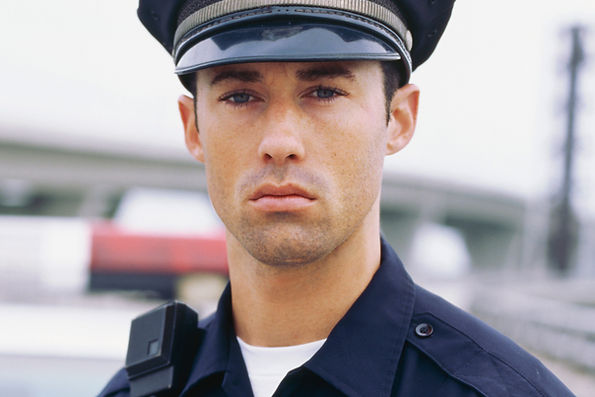 Police officer looking sternly