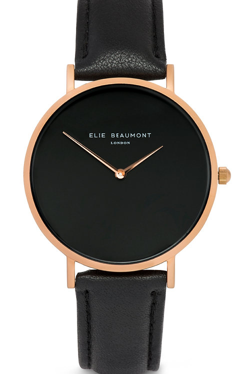 Black Round Faced Watch With Leather Strap
