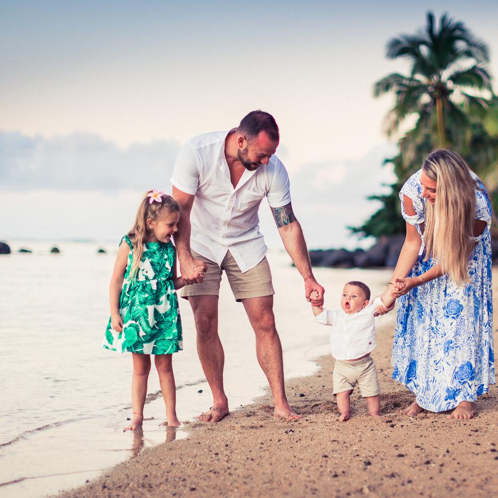 a family on vacation enjoying the beach