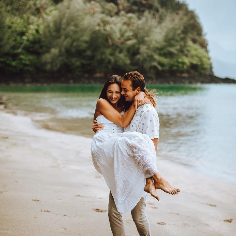 a photo session on a white sand beach