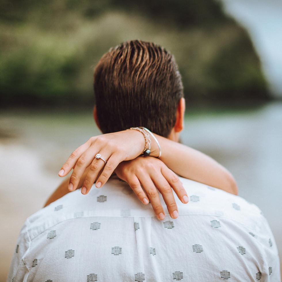 a newly engage couple on a beach
