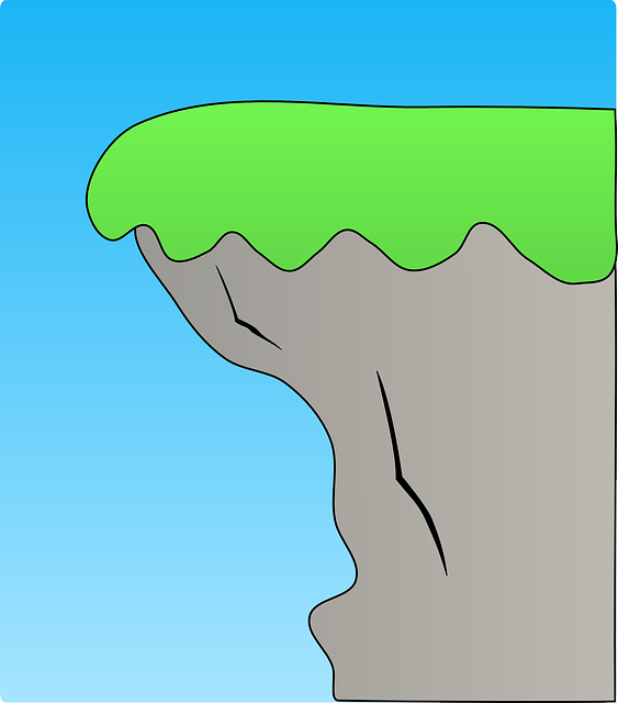 Cliffhanger with grass on top in front of a blue background.