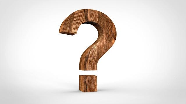 A Dark Wooden Question Mark