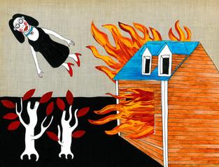 Donna vola via da casa in fiamme