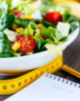 Fitness nutrition diary, salad and measu
