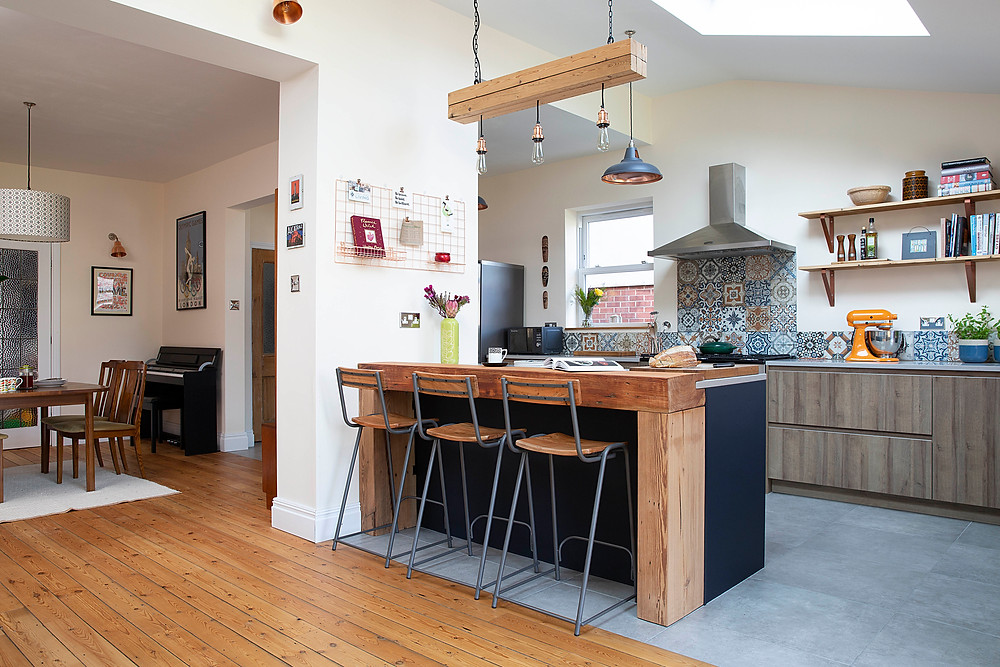 Open plan kitchen with reclaimed wood features