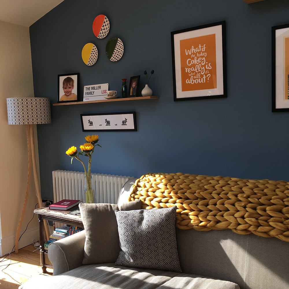 Bright living area with picture wall