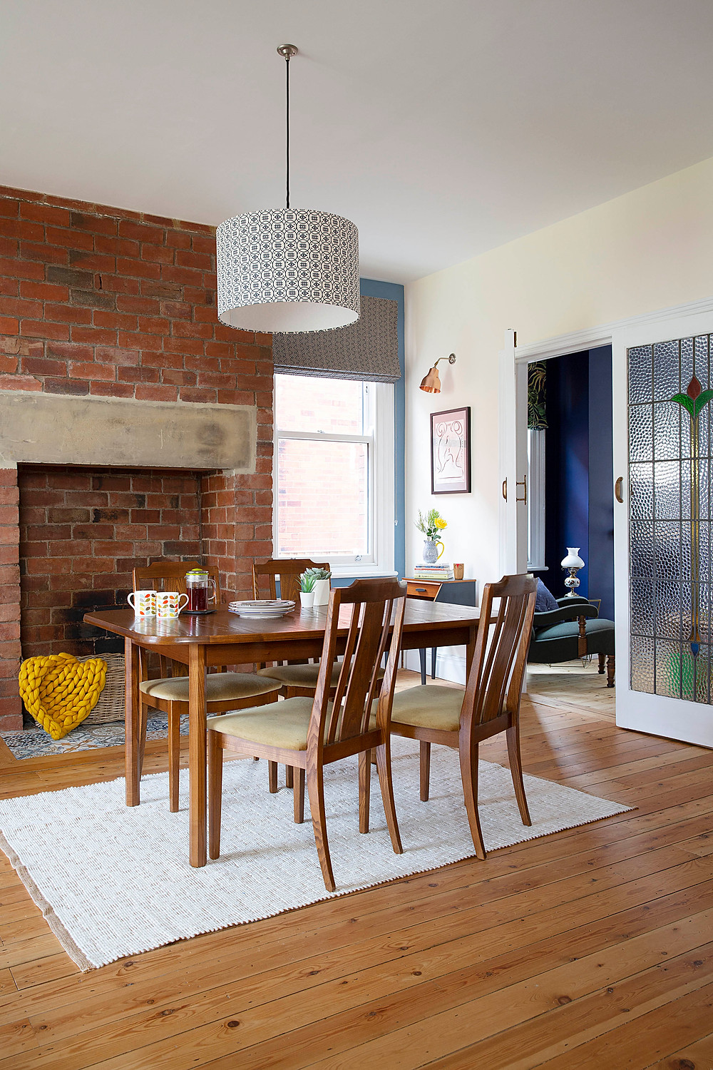 Mid century dining with exposed brick wall