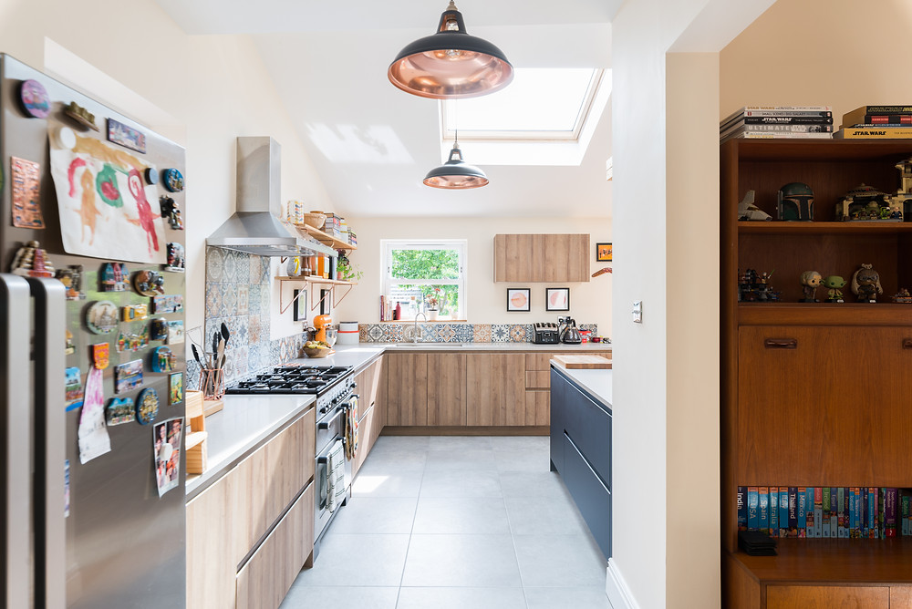 Bright kitchen extension with handle-less cupboards