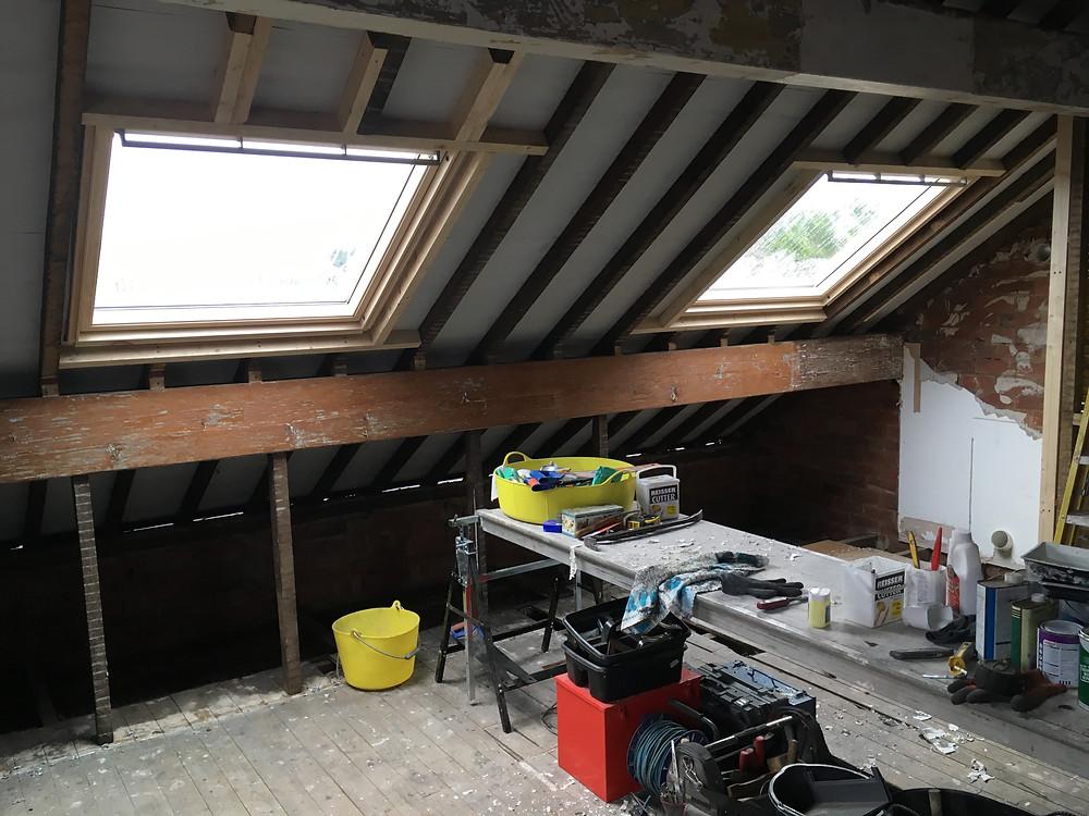 Roof windows being installed in loft bedroom