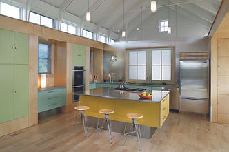 wood floor, stainless steel appliances, stainless steel countertops, stainless steel refrigerator, laminate, drop pendant lighting, modern kitchen, colorful ktichen, wooden stools