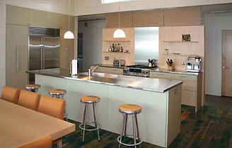 wooden stools, modern kitchen, stainless steel countertop, stainless steel appliances, wooden table, backsplash